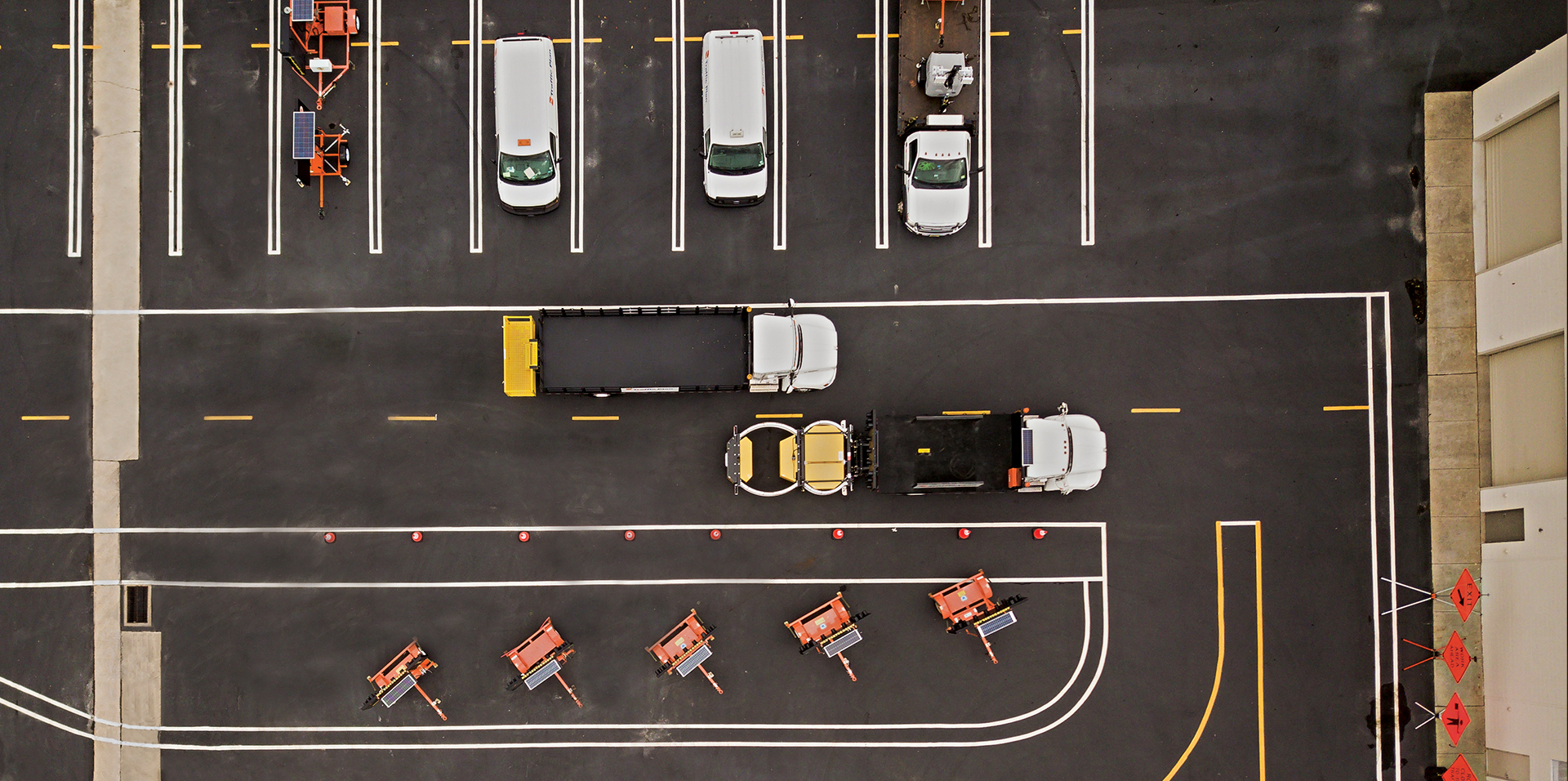aerial view of traffic plan company vehicles sitting in parking lot